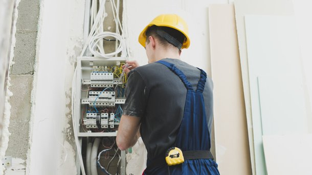 young-man-working-with-wires-at-switcher 23-2147743118